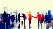 Business People Walking Commuter Rush Hour Handshake Concept