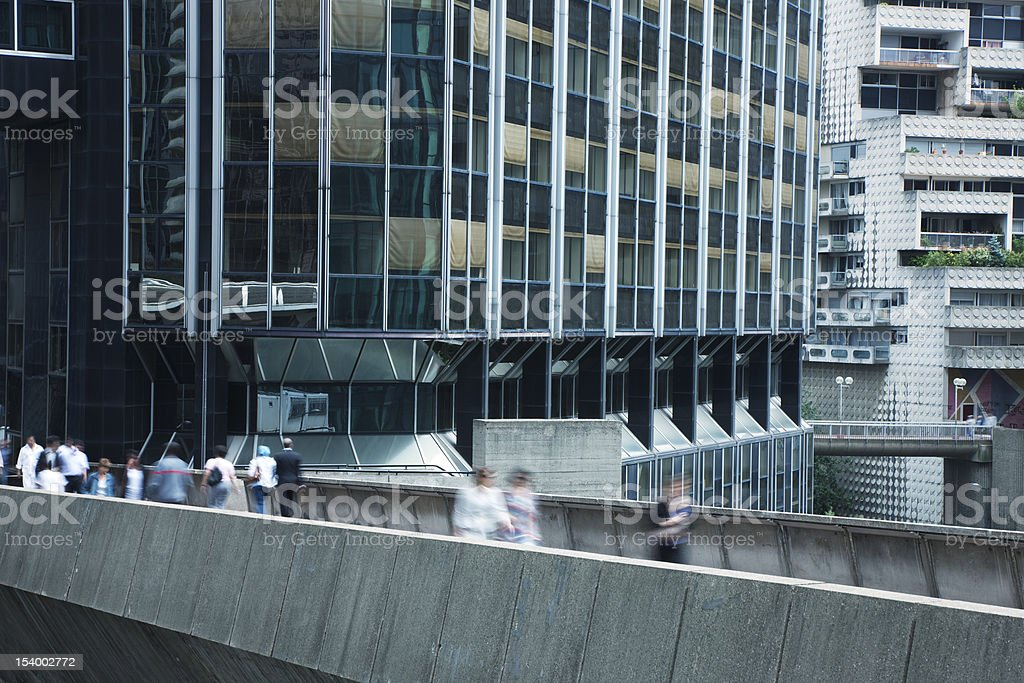 Business People Walking Down Elevated Walkway in Financial District, Paris royalty-free stock photo