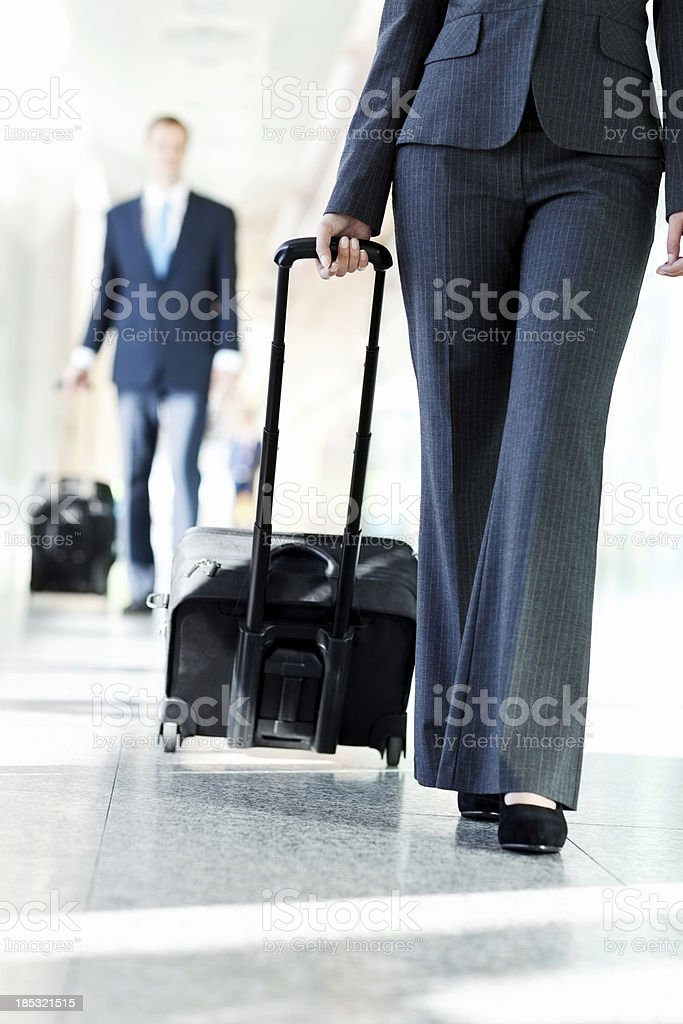 Business People Walking In Airport Hallway royalty-free stock photo