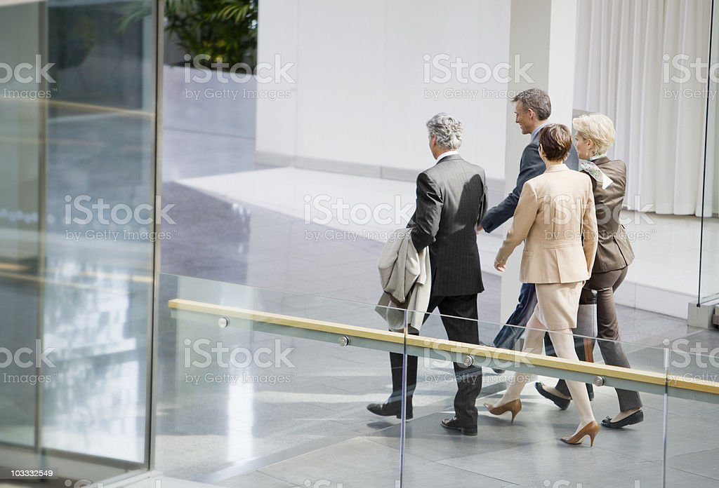 Business people walking in corridor royalty-free stock photo