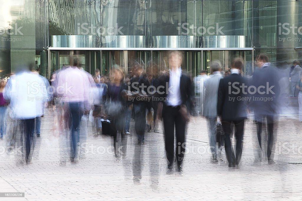 Business people walking in front of  an office building stock photo