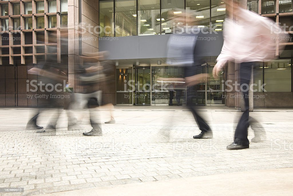 Business People Walking in Front of an Office Building royalty-free stock photo
