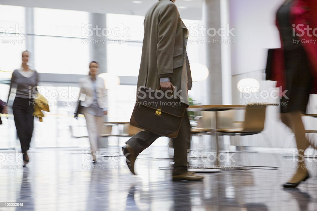 Business people walking in lobby royalty-free stock photo