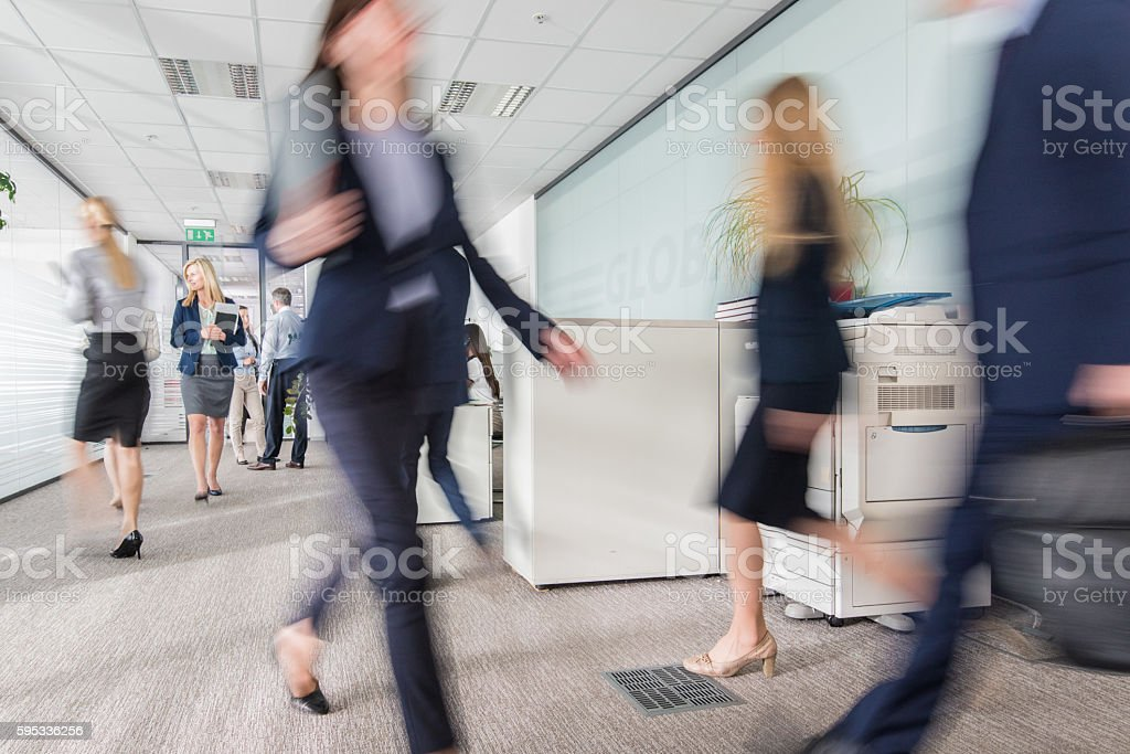 Business people walking in office stock photo