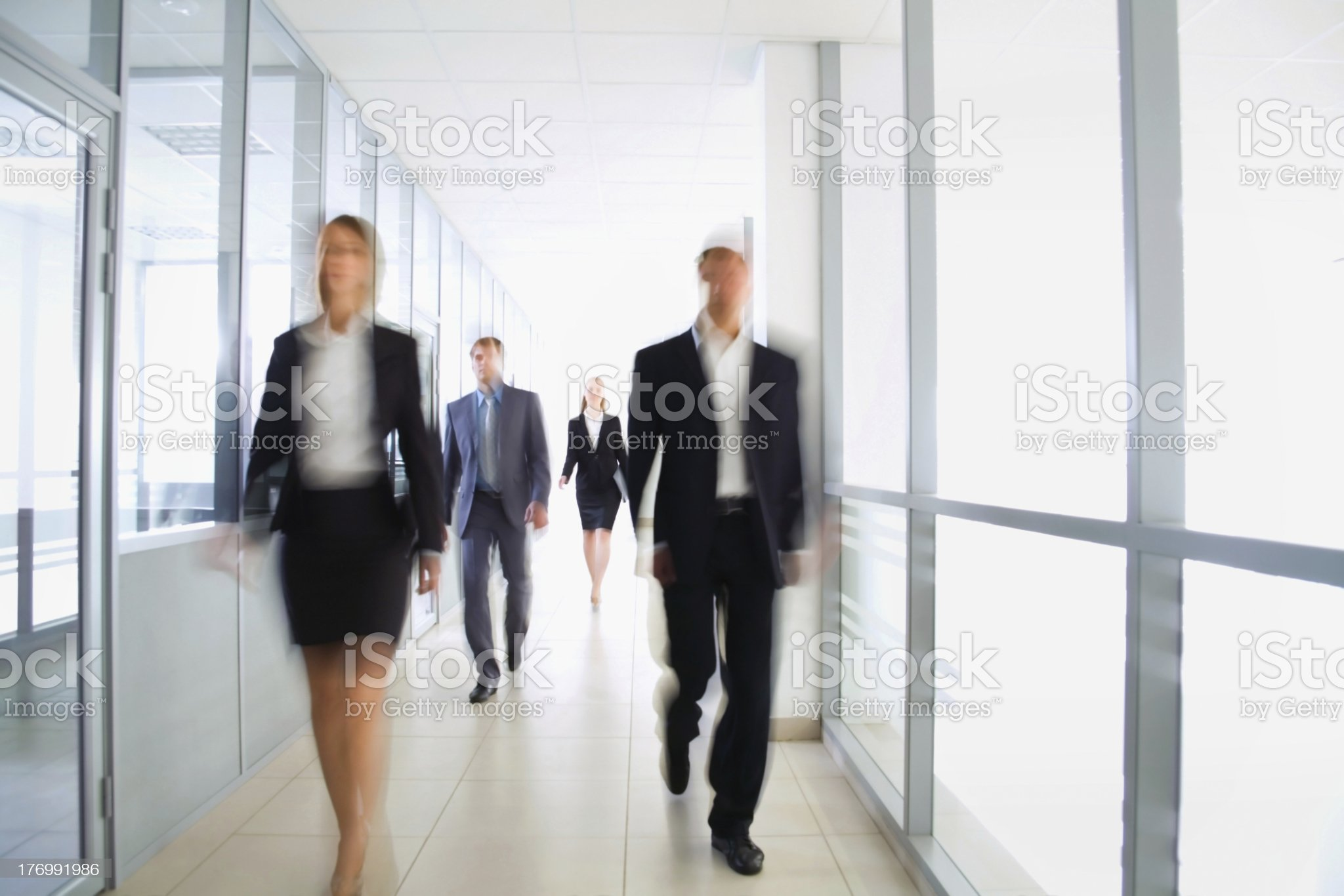 Business people walking in the hallway of office royalty-free stock photo