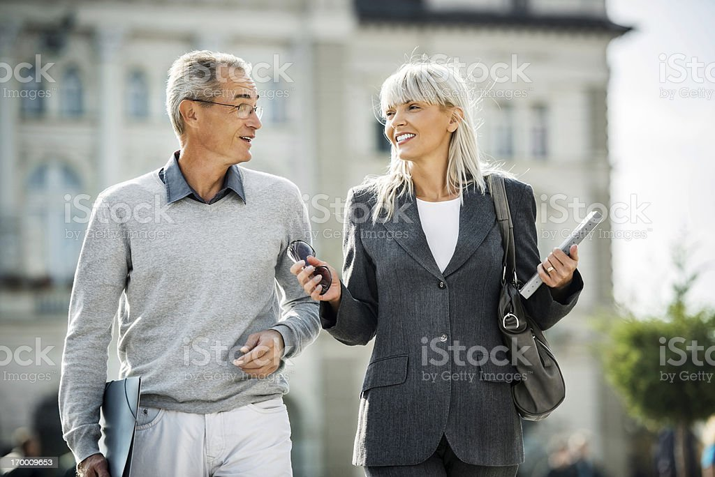 Business people walking in the streets. royalty-free stock photo