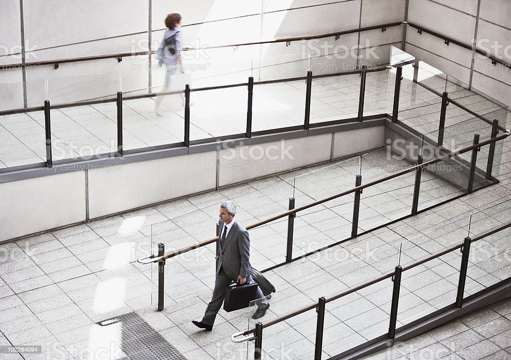 Business people walking on ramp royalty-free stock photo