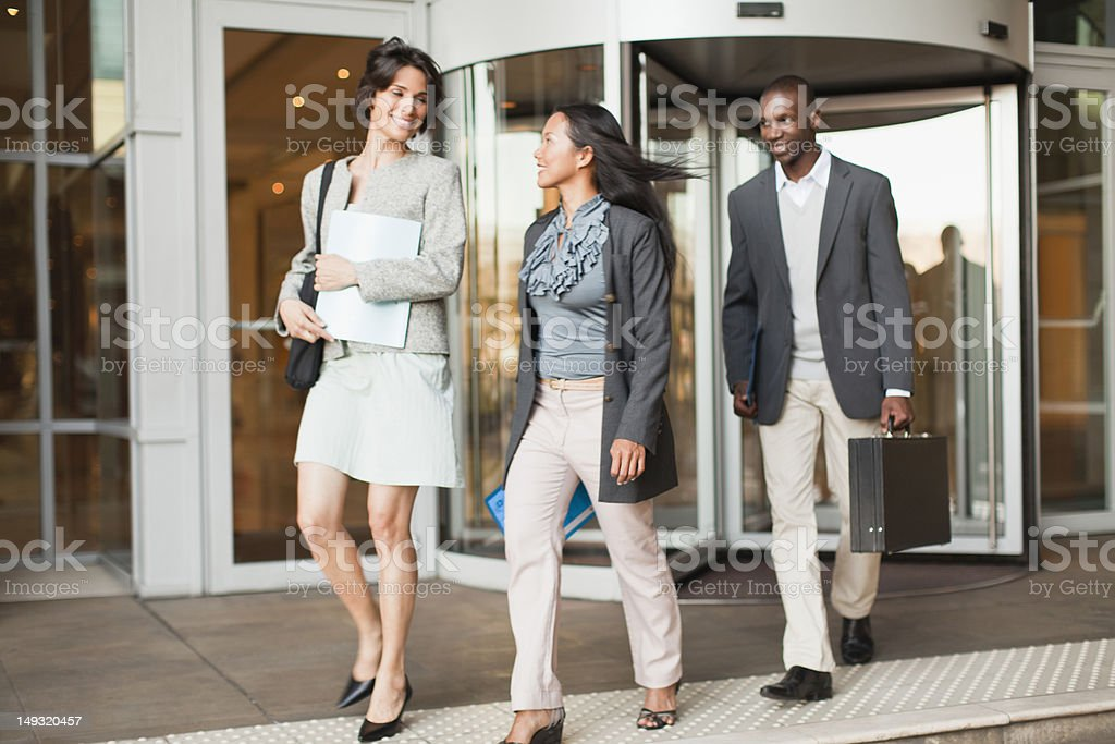 Business people walking on steps stock photo