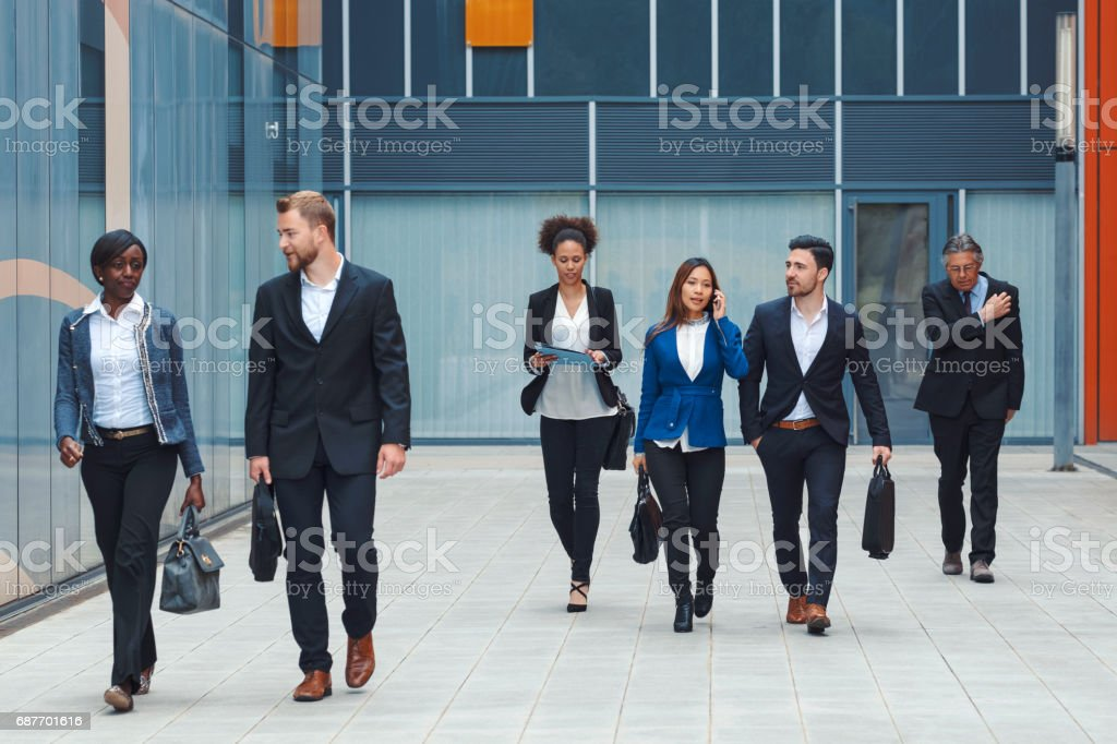 Business people walking on the street.