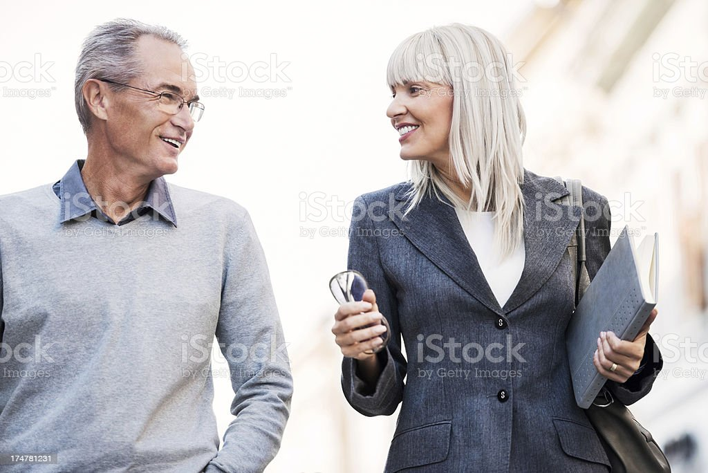 Business people walking outdoors and communicating. royalty-free stock photo