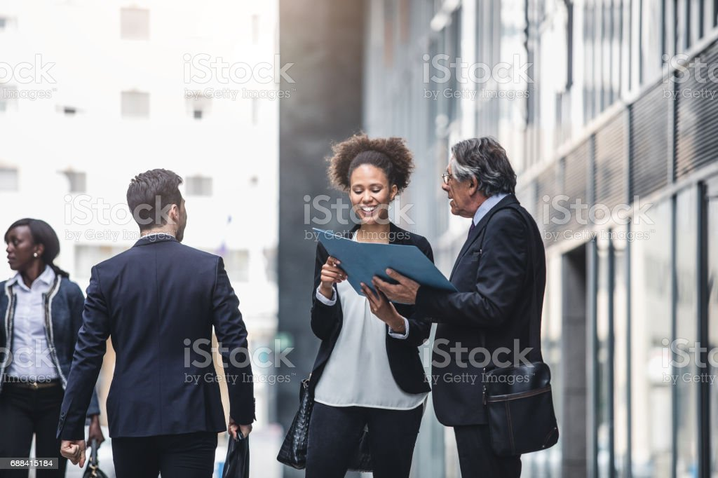 Business People Walking Outside The Business Building stock photo