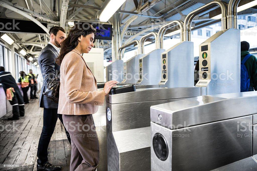 Business people walking through subway gates stock photo