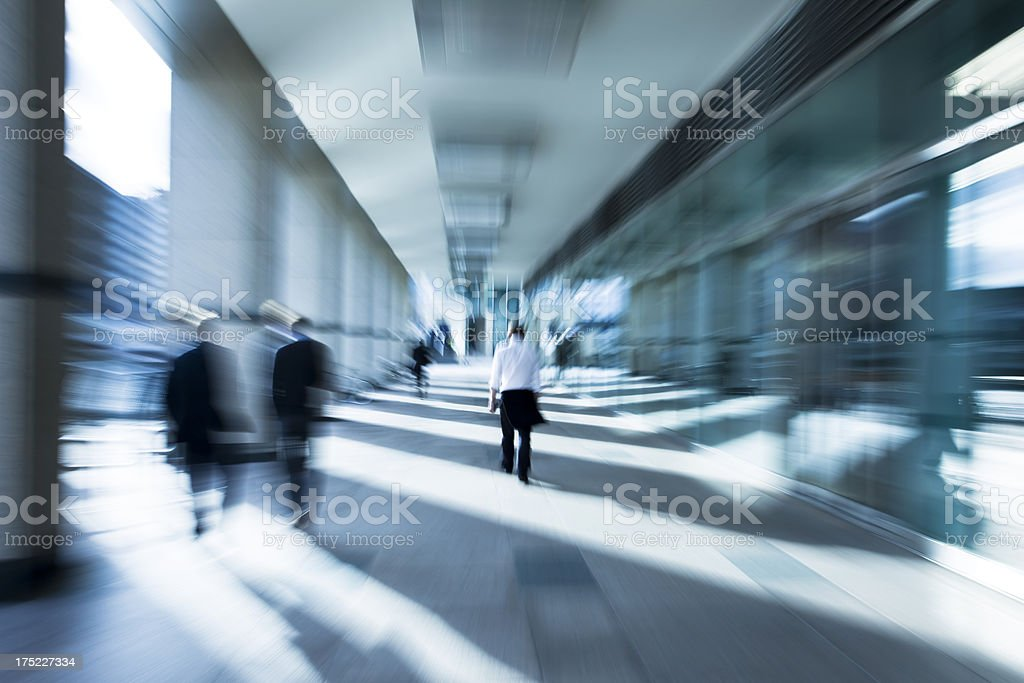 Business People Walking Through Sun Stripes in London's Financial District stock photo