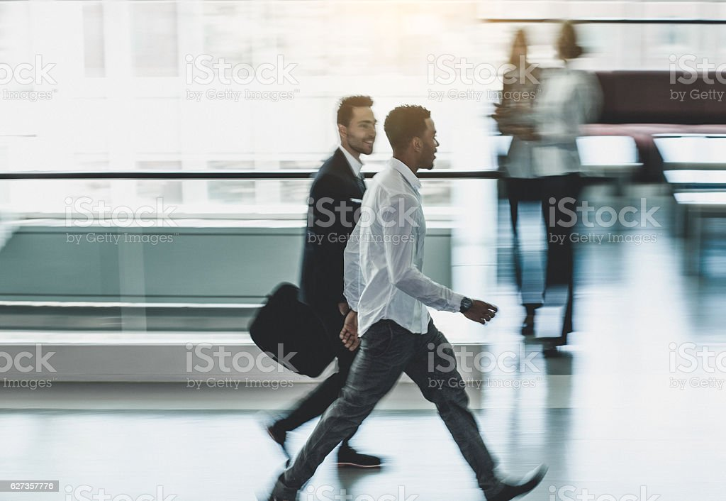 Business People Walking Through The Office Corridor stock photo