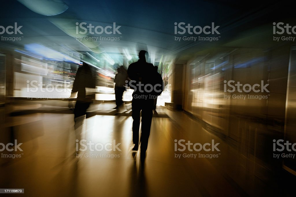Business People Walking Through the Tunnel, Blurred Motion stock photo