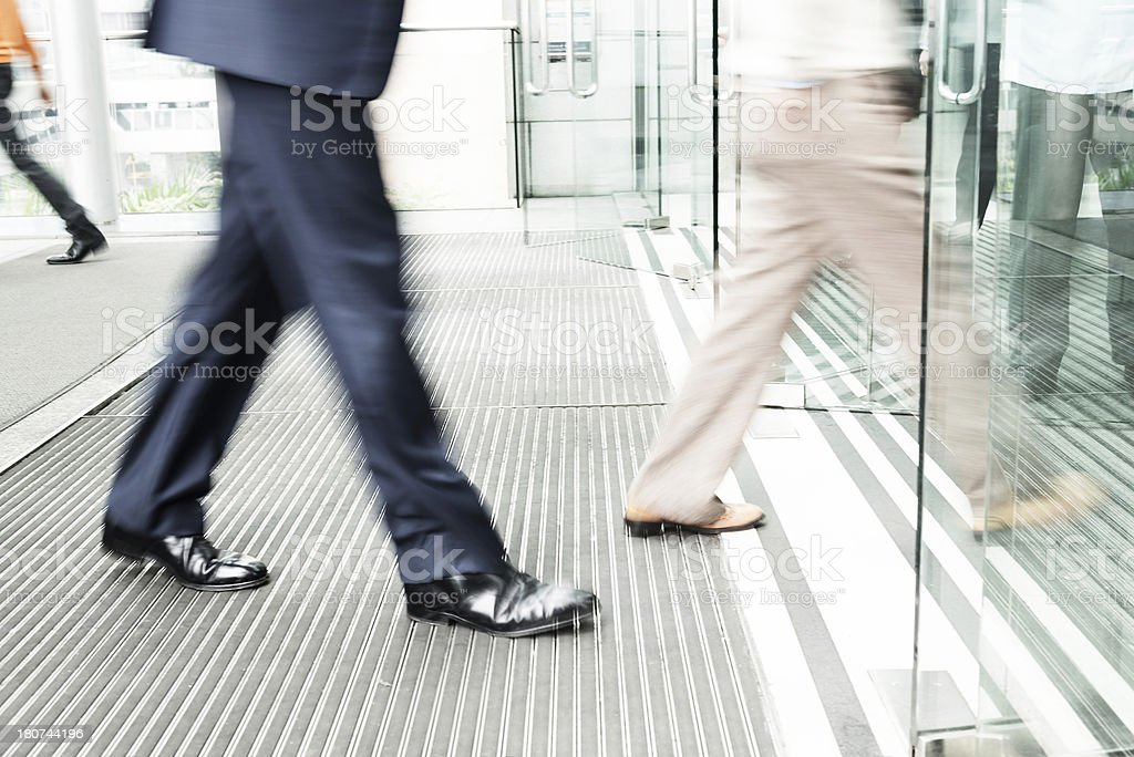 business people walking to office stock photo