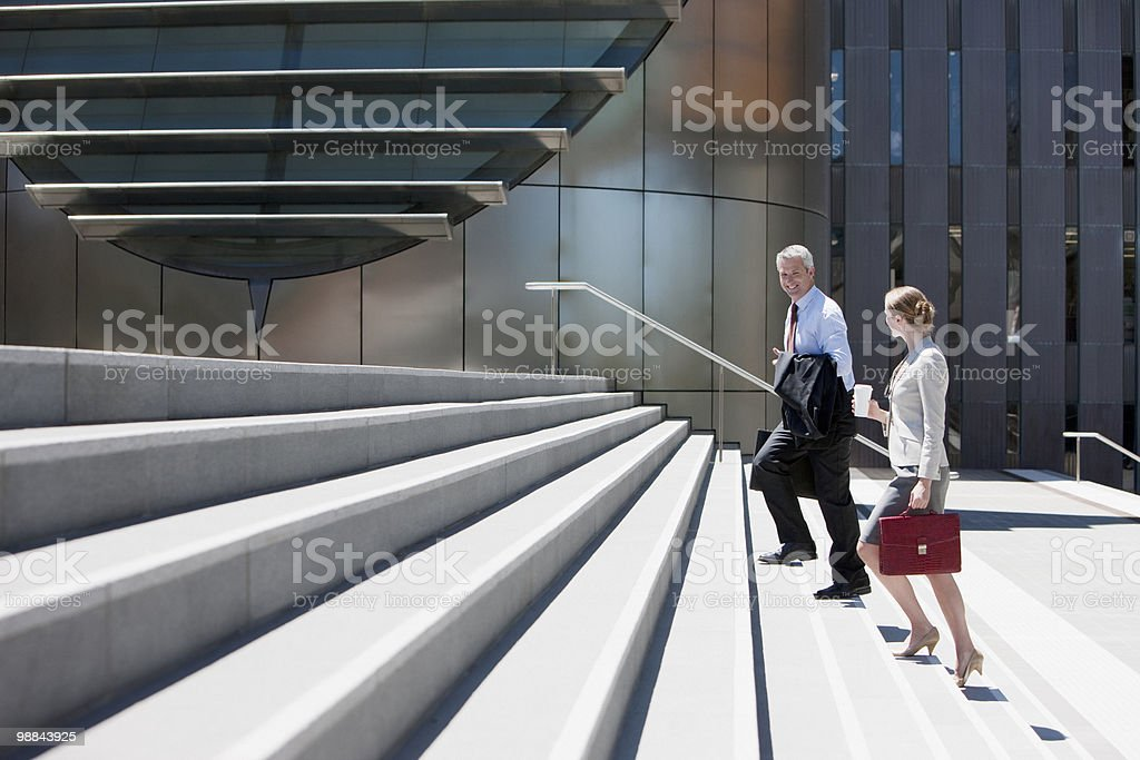 Business people walking up steps stock photo