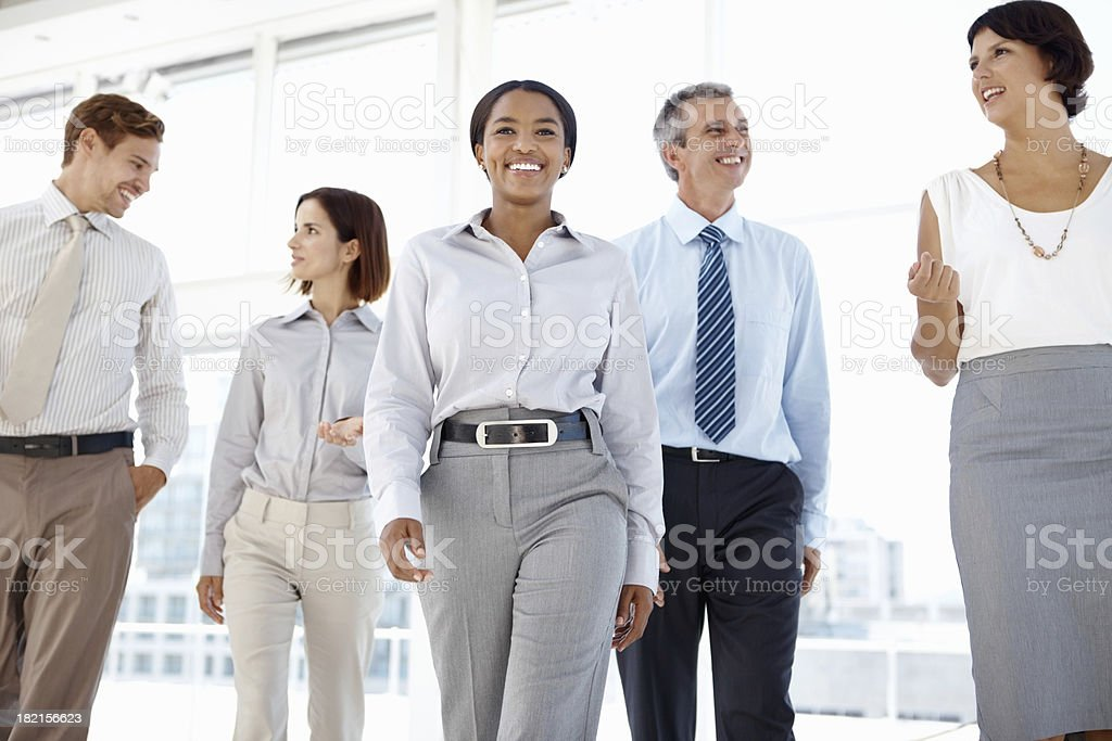 Business people walking while talking stock photo