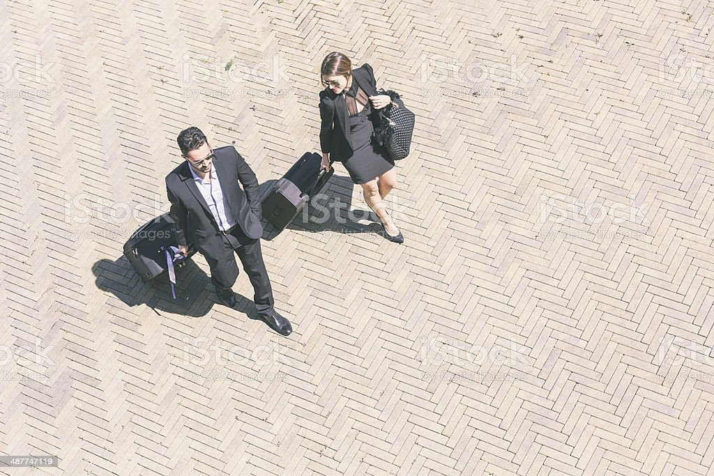 Business People Walking with Trolley Bag, Aerial View stock photo
