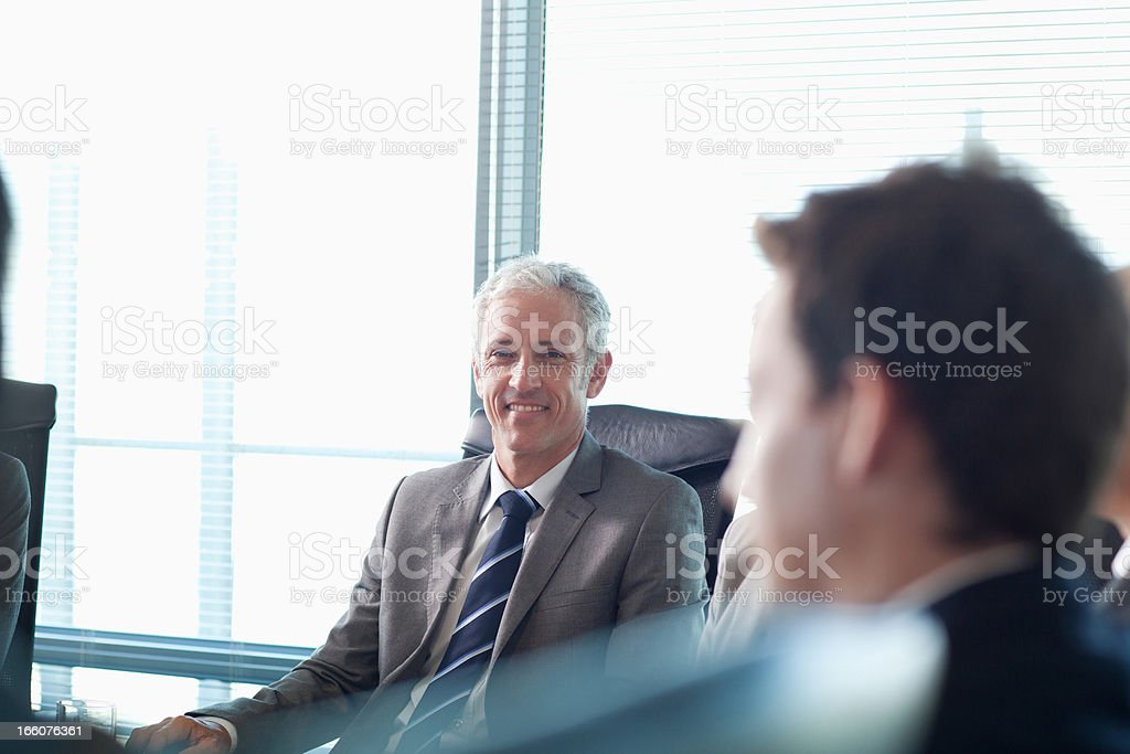 Business people watching presentation in conference room stock photo