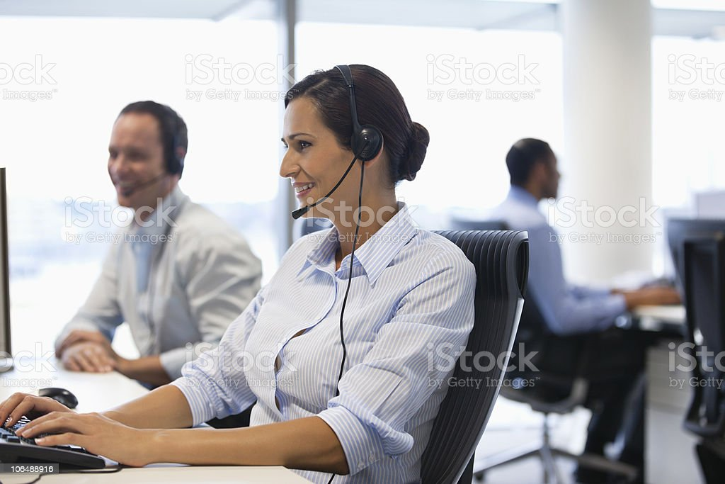 Business people wearing headset while working on computer in office royalty-free stock photo