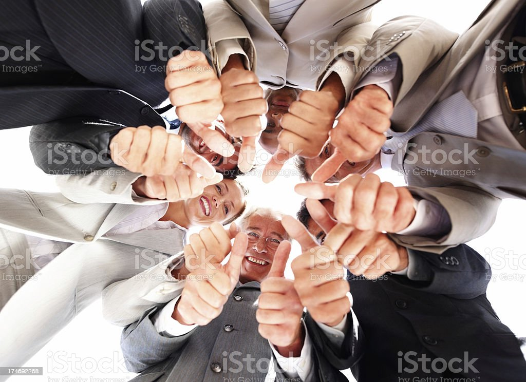Business people with clenched fist and thumbs out royalty-free stock photo