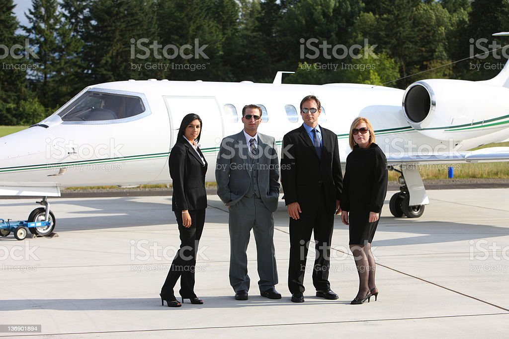 Business people with corporate jet royalty-free stock photo