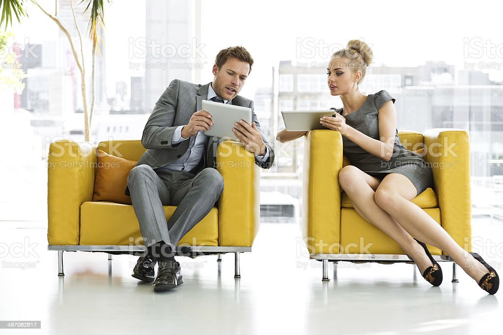Business people with digital tablets stock photo