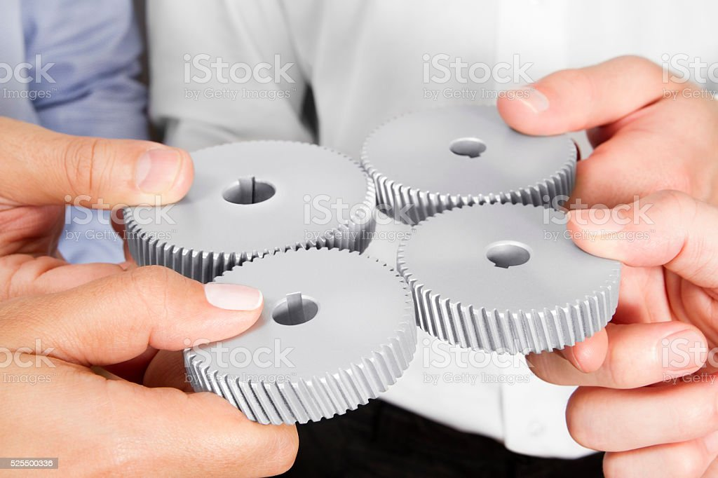 Business People with Gears in Their Hands stock photo
