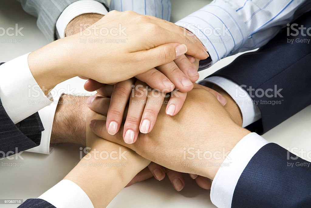 Business people with hands altogether royalty-free stock photo