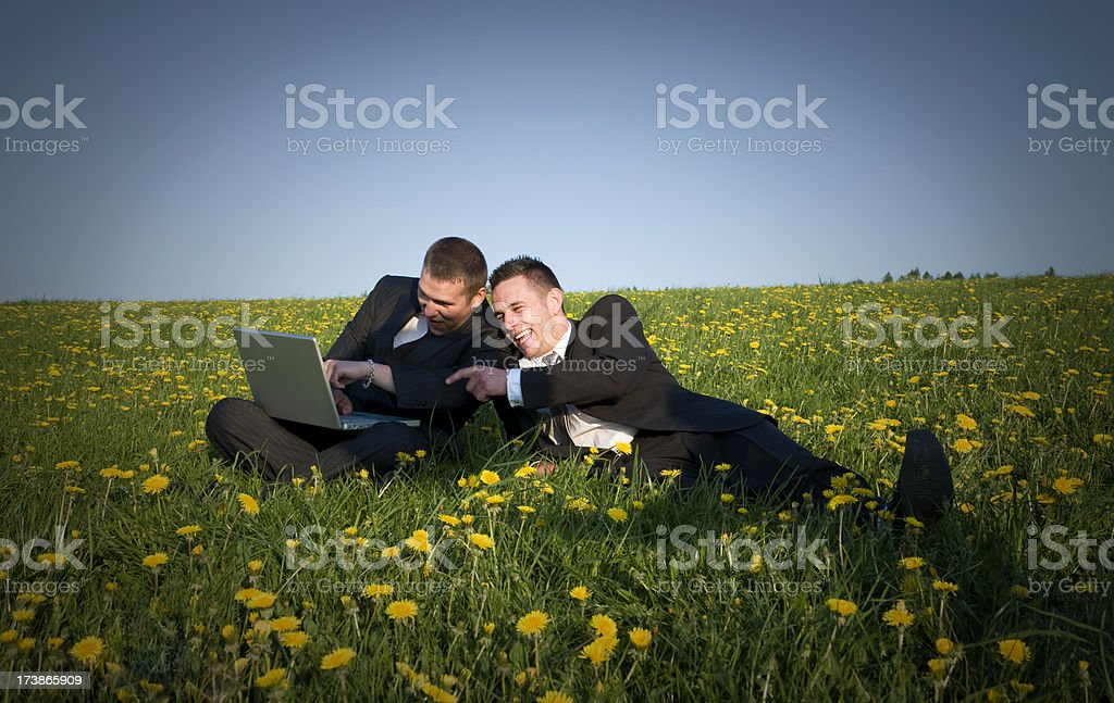 Business People with Laptop on meadow royalty-free stock photo