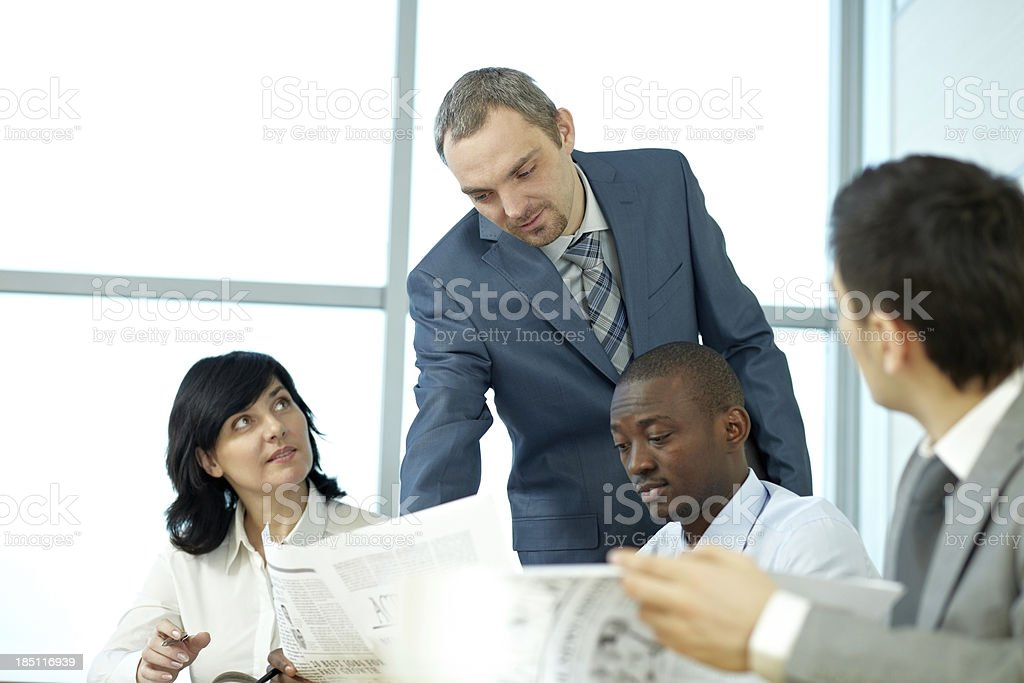 Business people with newspapers royalty-free stock photo