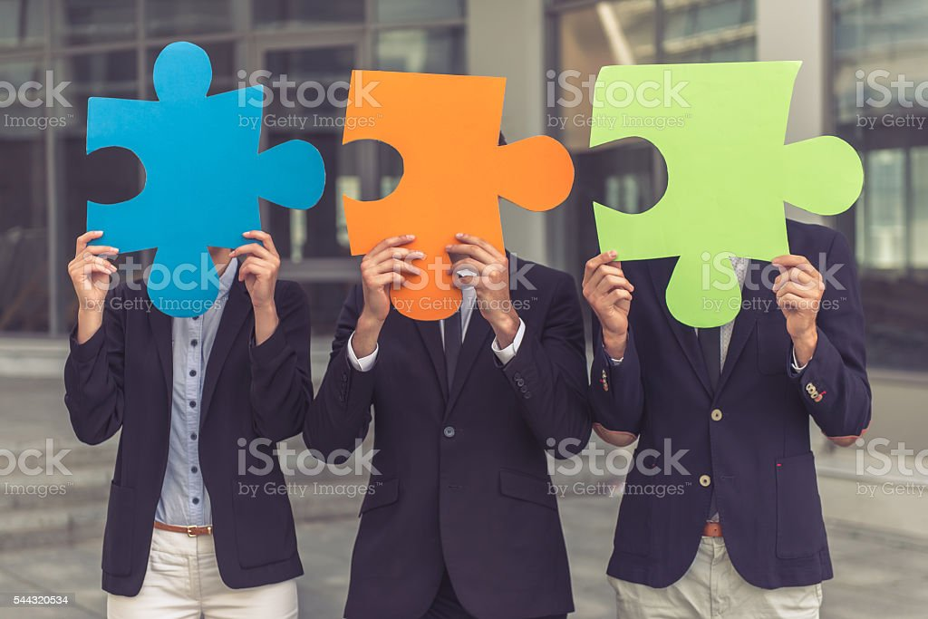 Business people with puzzles stock photo