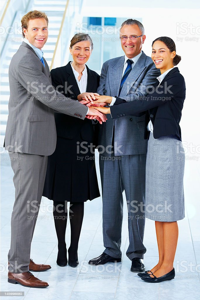 Business people with stacked hands royalty-free stock photo