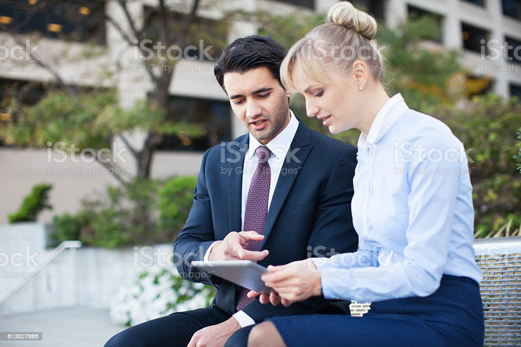 Business people with tablet outdoors stock photo