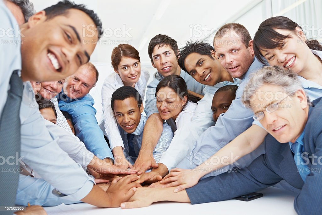 Business people with their hands together showing unity royalty-free stock photo