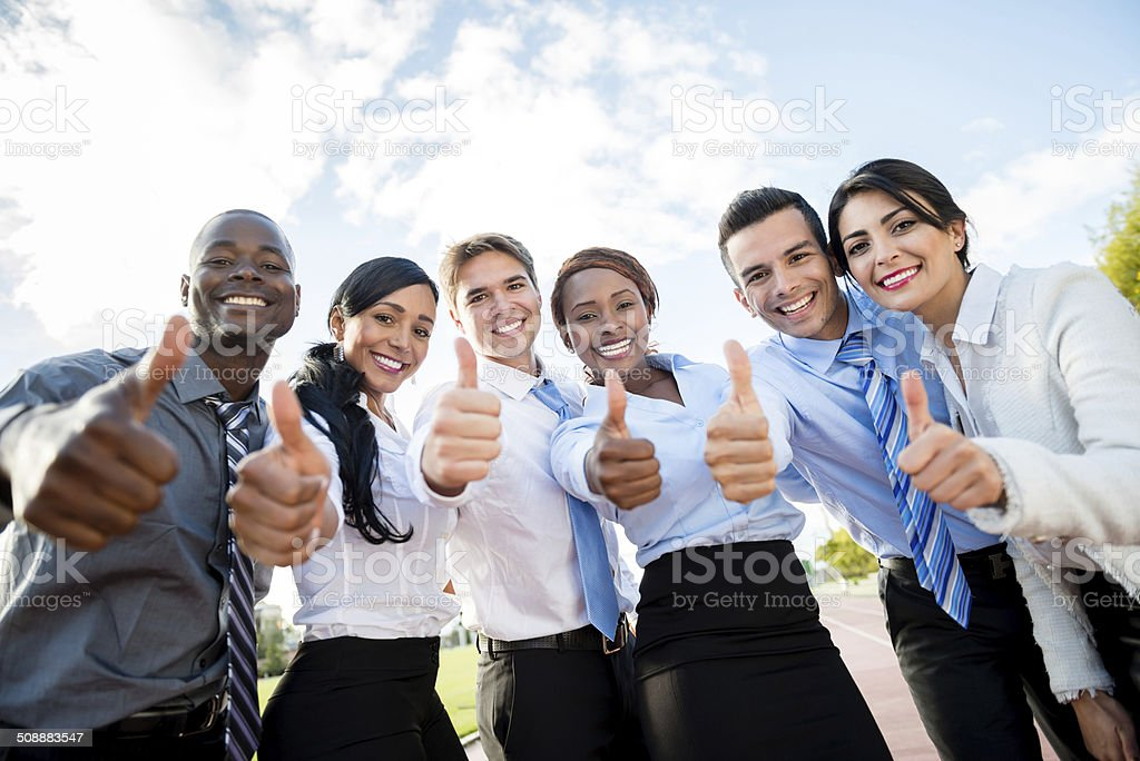 Business people with thumbs up stock photo