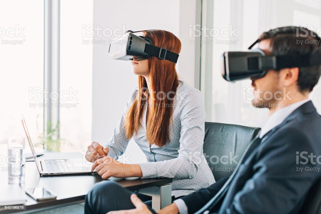 Business people with VR headsets stock photo