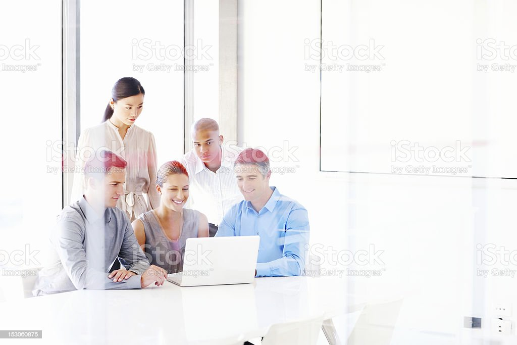 Business People Working Around a Laptop royalty-free stock photo