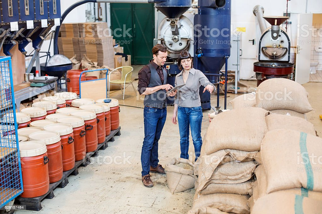 Business people working at coffee roasting factory stock photo