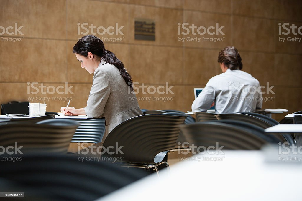 Business people working in cafe stock photo