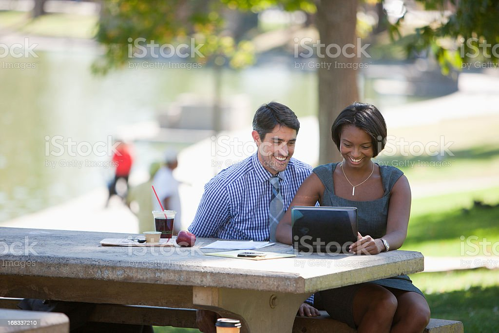 Business people working in park royalty-free stock photo