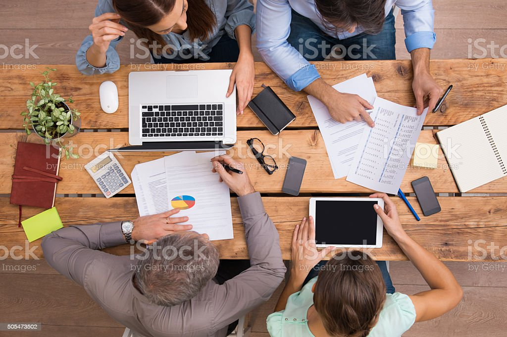 Business people working on desk stock photo