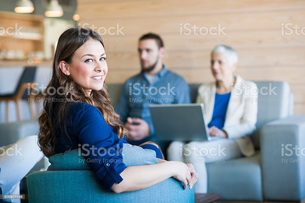 Business people working on laptop at cafe stock photo