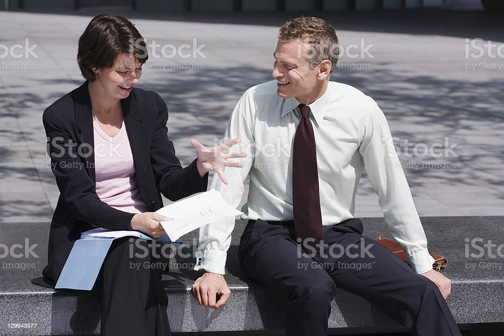 Business people working on steps stock photo