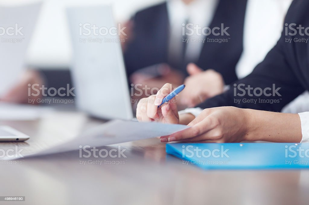 Business people working together at a meeting stock photo