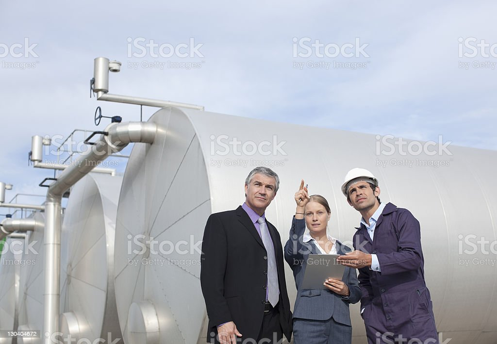 Business people working together by tanks royalty-free stock photo