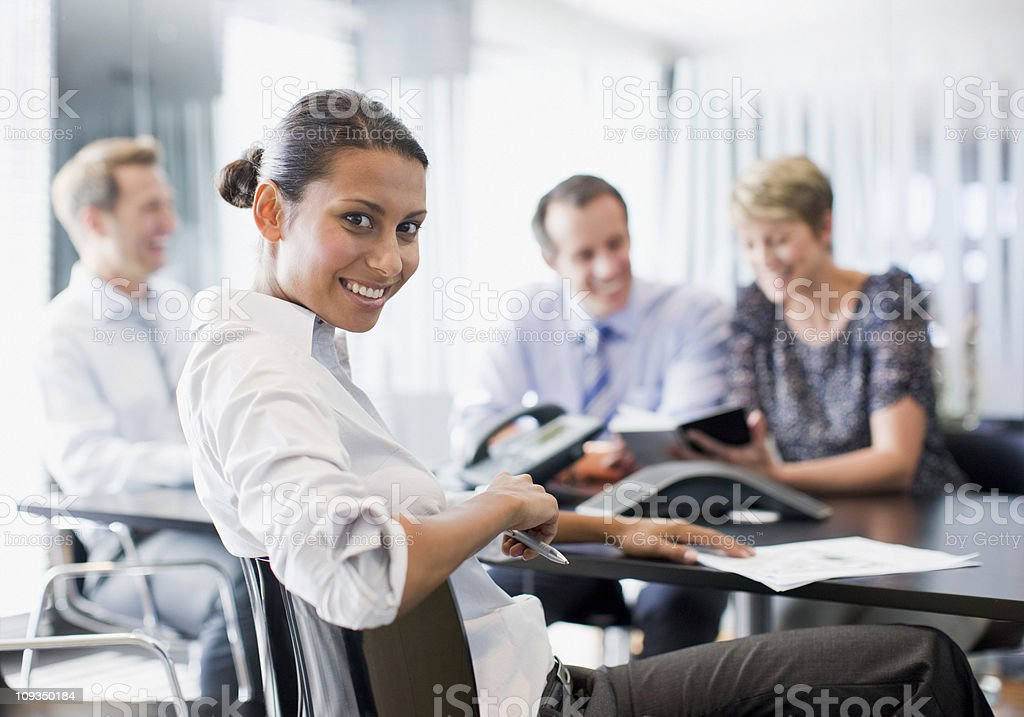 Business people working together in conference room stock photo