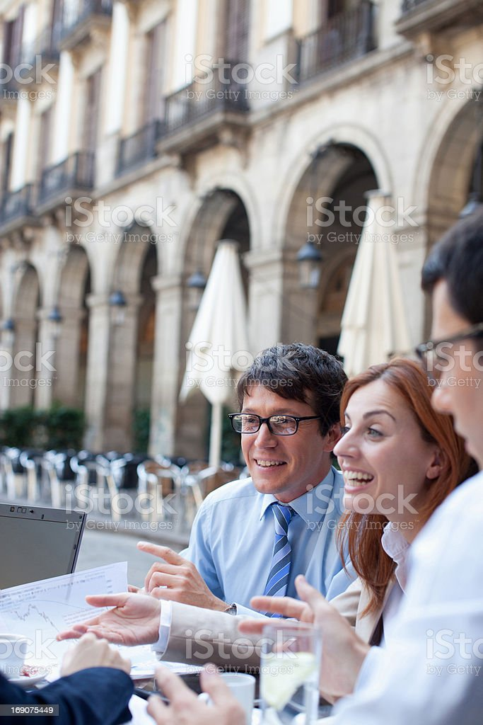 Business people working together in sidewalk cafe royalty-free stock photo