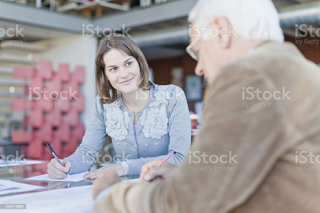 Business people writing in meeting stock photo